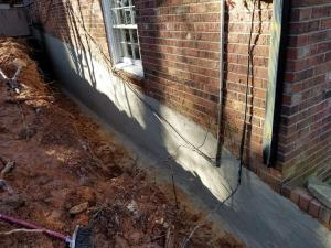 MORTAR MIX CEMENT ON WALL TO SEAL ANY UNCURED GAPS
